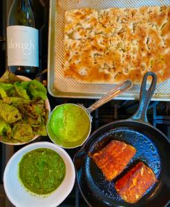 Seared Alaskan Halibut, foccacia, pea puree, dough wines chardonnay